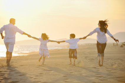 happy young family have fun on beach © .shock - Fotolia.com